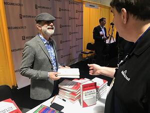 Bruce_Schneier_signs_books_BOS19